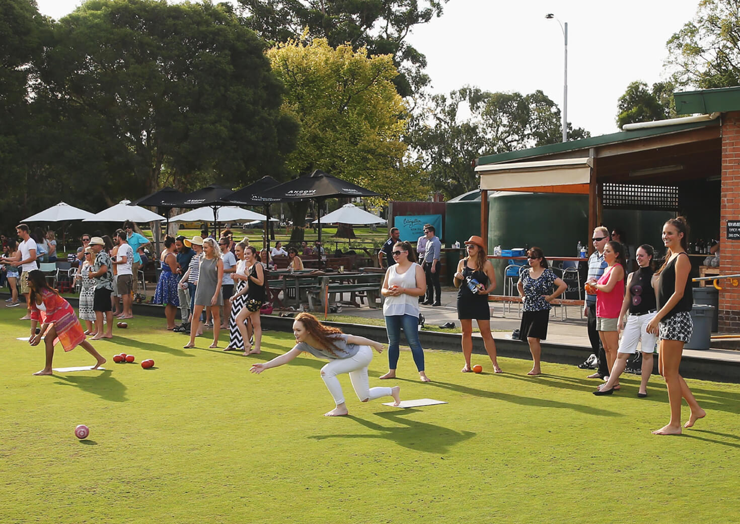 Young people playing bowls game